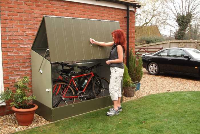 A woman open a protect a cycle storage system - Trimetals