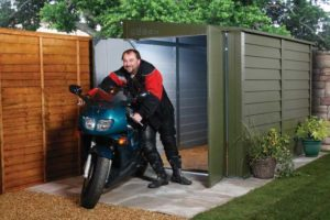 A man takes his motorbike out of a protect a bike storage system Trimetals